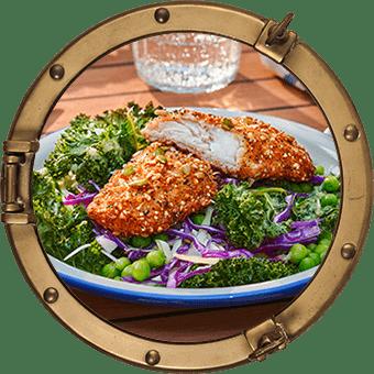 Fröbakade fiskfiléer med grönkålssallad