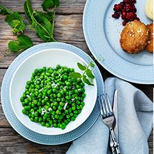 En skål full med gröna ärter från Findus.