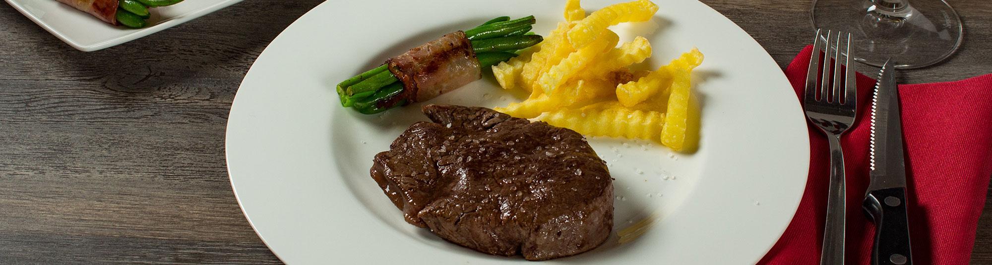 Iglo Steak mit Fisolen im Speckmantel