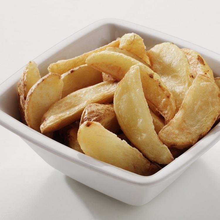 Produkt nærbilde: Potetbåter med skall, i porsjonsskål.