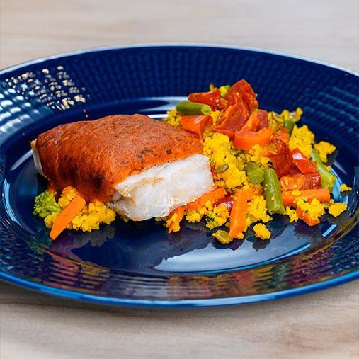 Fisk med tomat och mozzarella på en bädd av couscous