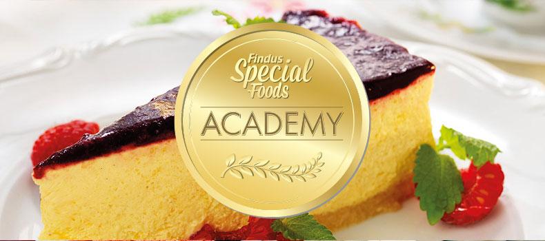 Special Foods academy logotyp ovanpå en cheesecake
